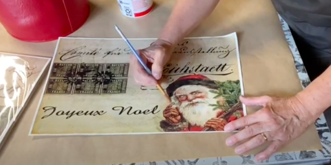 Tear out decoupage images after outlining them with water on a paintbrush