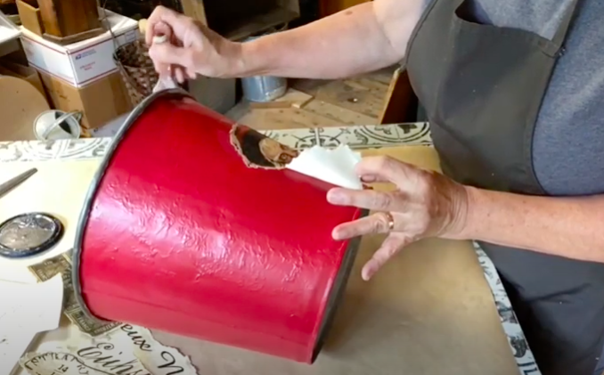 Decoupage Monahan paper onto bucket surface