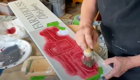 Apply red chalk paint to Christmas stencil