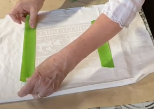 use wide tape to secure stencil on all four sides